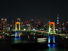 220px-Rainbow_colored_Rainbow_Bridge_at_night
